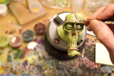 Detailed painting of one of the zombie heads for ParaNorman, the new 3D stop-motion comedy thriller. Credit: LAIKA, Inc.